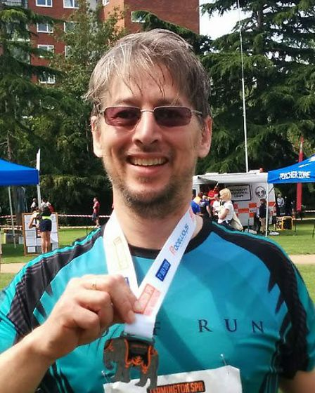 David Woo with his medal from the Leamington Spa Half-Marathon. Picture: courtesy of David Woo.