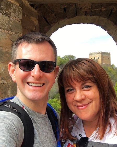 Critical care paramedic Tony Stone and bereavement officer Caroline Green on the Great Wall of China