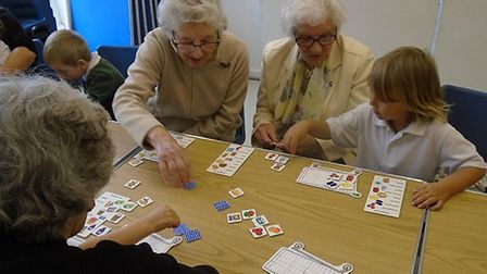 The pupils and parishioners meet every month for colouring, board games and more. Picture: Supplied