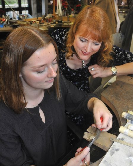 First year jewellery apprentice Maisie Sale with Harriet Kelsall making personalised pendants at the