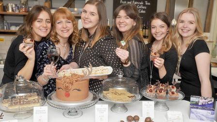 Staff offering festive food and mulled wine, second left at the Harriet Kelsall Bespoke Jewellery Ch