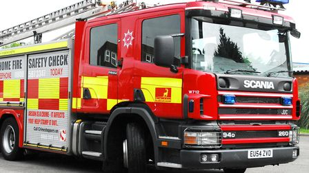 Firefighters from Hitchin, Baldock and Stevenage put out a domestic fire in Hitchin. Picture: Archan