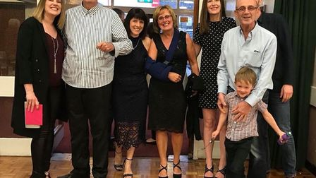 Peter Dunn (second from left) and Eleni Koureas (fourth from right) with their two families. Picture