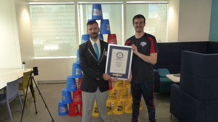 A Guinness World Records representative presents Stevenage's James Acraman with his certificate. Pic