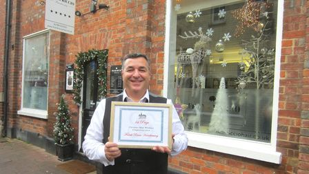 Frank Ricco whose hairdressers' shop window won first place