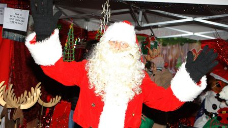 Stevenage Christmas Lights Switch On - Father Christmas entertains the crowds.Picture: Karyn Hadd