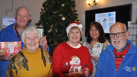 Members of the Rotary Club of Hitchin Tilehouse delivering Christmas presents to the residents of th