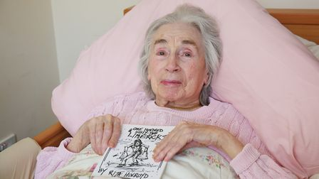 Rita Holroyd with her book of limericks. Picture: DANNY LOO