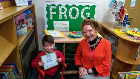 Reception pupil Haider Khalid with his winning entry, alongside headteacher Rouane Mendel. Picture: