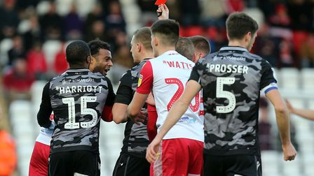 Referee Ollie Yates shows a red card to Tom Soares of Stevenage during Stevenage vs Colchester Unite