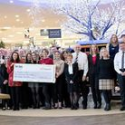 Glasswells staff hand over funds to the My WiSH charity. Picture: CONTRIBUTED
