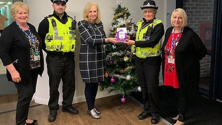 Sharon Taylor, members of Stevenage Police and senior staff at The Haven pose with the new contactle