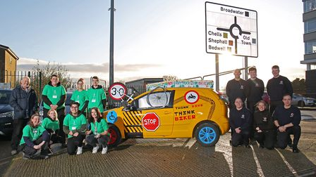 North Herts College car body and paintwork students with Firefighters from Stevenage Green Watch at