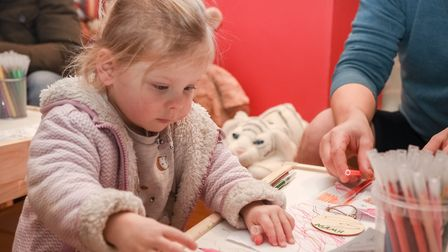 Niamh Lederer (two) colours her wish bauble at the Saffron Walden Santa Grotto, put on by BID. Pictu