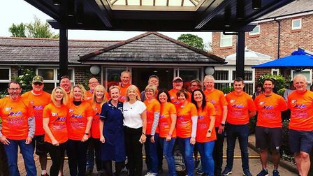 Trekkers assembled at the hospice before setting off for the Three Peaks challenge. Picture: Garden