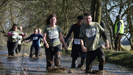 People participating in the Muddy Mayhem 2019 charity fundraiser for Garden House Hospice Care at Kn