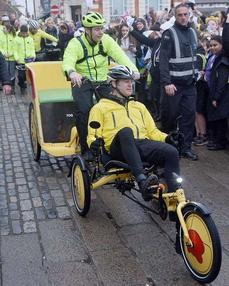 Hundreds cheered on the Children in Need rickshaw as it passed through Hitchin this afternoon. Pictu