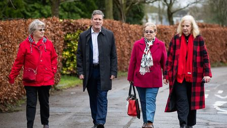 Labour MP Sir Keir Starmer walks with Labour council members during a visit Stevenage, following th