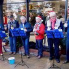 The club's handbell group, The Tinkerbells, performing in the market square. Picture: CONTRIBUTED.