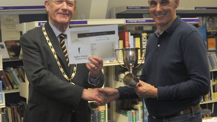 Cllr Richard Freeman congratulating Clive Downes on 1st awards in Black & White Prints and Portraits
