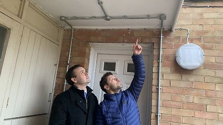 Resident Matt Endersby shows Stevenage MP Stephen McPartland where he believes contractors have dril