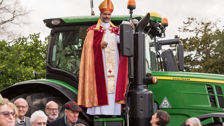 Bishop of Bradwell, John Perumbalath, blessing the plough and tractor. Photo: SAFFRON PHOTO.