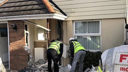 Police and firefighters inspect the scene at the property in Buntingford. Picture: Herts Fire and Re