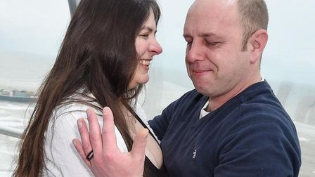 The couple share a teary-eyed moment as they prepare for a new life together. Picture: Supplied