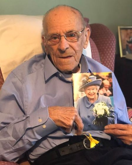 George Clark with his birthday card from the Queen. Picture: Fiona Field.