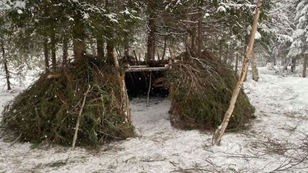 The team constructed a natural shelter to sleep in on day two of their survival phase. Picture: Clai