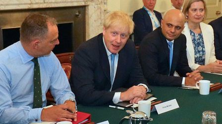 Boris Johnson with Sir Mark Sedwill, Sajid Javid, Amber Rudd, and Lee Cain (back right) as the PM holds his first cabinet...