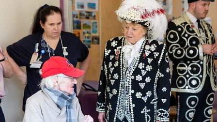 Pearly Queen of the Borough Wendy Loftus chats to staff and patients during a visit to celebrate the