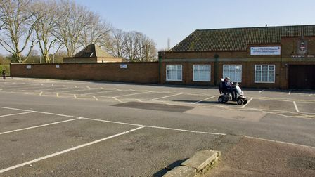 A man on his mobility scooter takes a shortcut across the swimming pool's empty car park. Picture: S