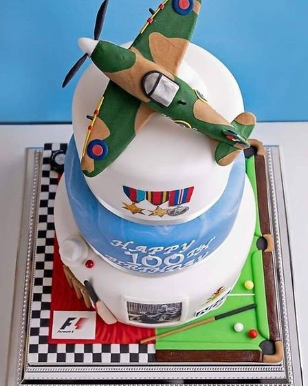 The cake included elements of Captain Tom Moore's life and loves. Picture: Darren Miles from Miles o