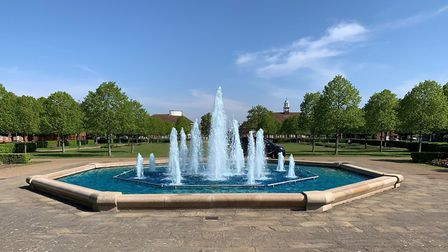 The fountains in Broadway Gardens have been turned blue in support of our NHS key workers. Picture: