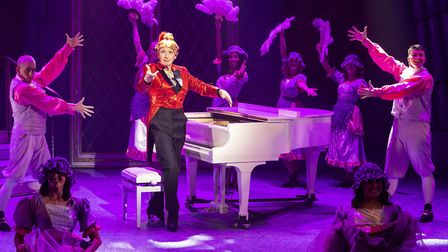 Paul Laidlaw as Dame Dotty Derriere at the piano in pantomime Beauty and the Beast at the Gordon Cra