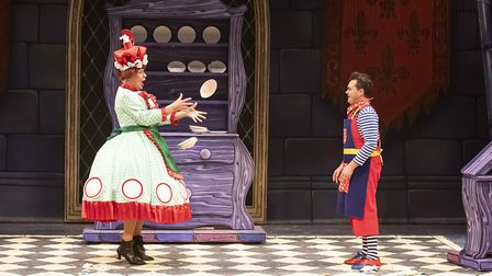 Dame Dotty Derriere (Paul Laidlaw) and Potty Pierre (Aidan O'Neill) smashing plates in pantomime Bea