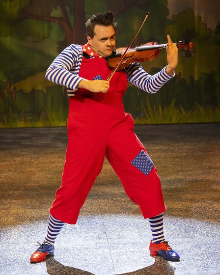Potty Pierre (Aidan O'Neill) playing the violin in pantomime Beauty and the Beast at the Gordon Crai