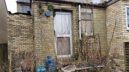 Residents say the windows of uninhabitable 62 have been boarded up for a number of years. Picture: S