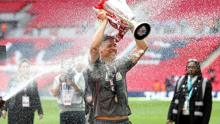 Rotherham United's Alex Revell celebrates promotion with the trophy after the game. Picture: JOHN W