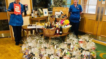 Community nurses at Hitchin's Foxholes Care Home being gifted luxury hampers for International Nurse