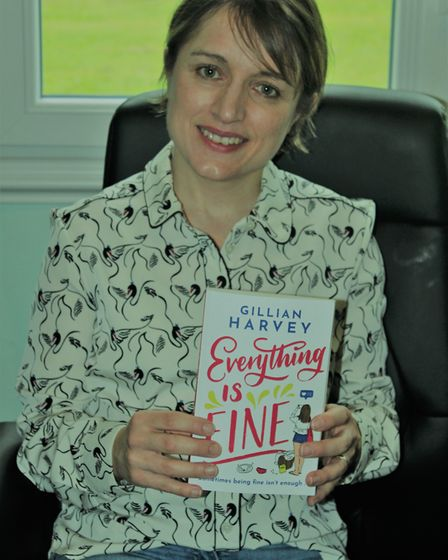 Gillian poses with her debut novel, Everything is Fine. Picture: Gillian Harvey
