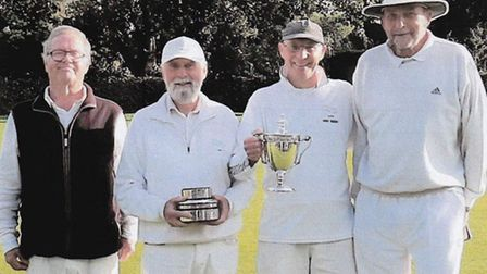 Letchworth Croquet Club's winning Longman Cup team with the trophy