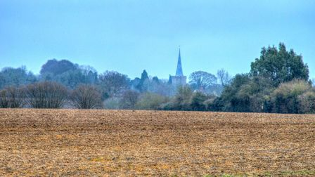 Swathes of open countryside will be destroyed by the development. St Nicholas Church is visible in t