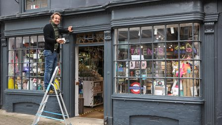 Peter Hingston from Talents in Saffron Walden cleans up the outside of his shop during the big clean