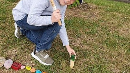 Eddie, 10, puts a marker at 3,575 stones. Picture: Dawn Parnell
