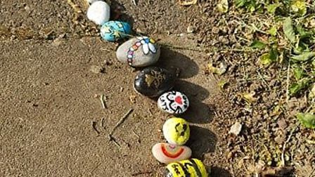 People of all ages have added brightly-painted stones to Covid the Cobra. Picture: Dawn Parnell