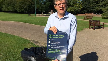 Cllr Steve Jarvis holds up NHDC's new 'Don't Be a Tosser' anti-littering poster. Picture: Chris Day