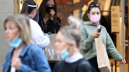 Face coverings must be worn in shops from July 24, or you may face a fine. Picture: Andrew Milligan/