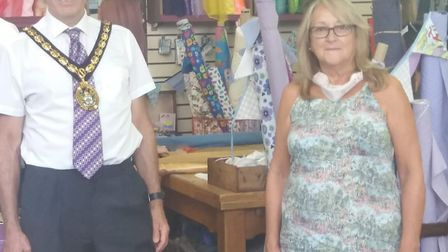 Stevenage's Mayor Cllr Jim Brown poses with Pamela Waterman of Bows and Buttons. Picture: Leah Codli